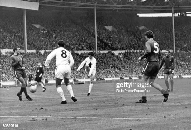 20th May 1967 FA Cup Final at Wembley Tottenham Hotspur 2 v Chelsea 1 Tottenham Hotspur winger Jimmy Robertson shoots past Jimmy Greaves and...