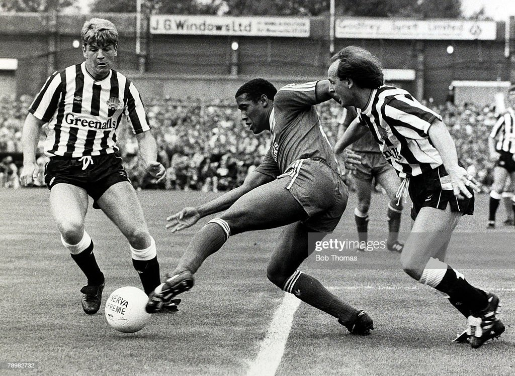 Sport. Football. pic: 20th September 1987. Division 1. Newcastle United 1.v Liverpool 4. Liverpool's John Barnes evades Newcastle United's Glyn Hodges, left, and David McCreery. John Barnes played for Liverpool 1987-1997 and in his time at the club was vo : News Photo