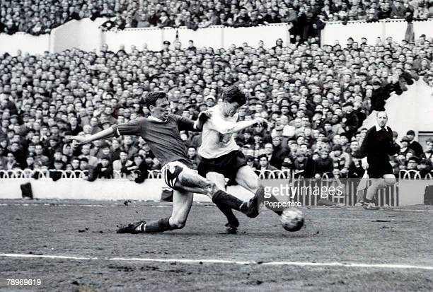 21st 1964, Tottenham Hotspur v Manchester United at White Hart Lane, Manchester United's Paddy Crerand slides in to tackle Tottenham Hotspur's Jimmy...