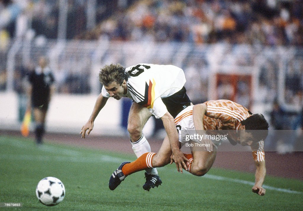 Sport. Football. pic: 21st June 1988. European Championship Semi-Final in Hamburg. West Germany 1 v Holland 2. West Germany's Rudi Voller clashes with Holland's Berry Van Aerle. Rudi Voller won 90 international caps 1982-1994. : News Photo