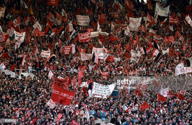 21st May 1977 1977 FA Cup Final at Wembley Manchester United 2 v Liverpool 1 A mass of Manchester United fans waving flags and banners to cheer on...