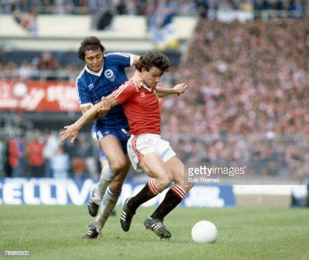 21st May 1983 FA Cup Final at Wembley Brighton and Hove Albion 2 v Manchester United 2 aet Manchester United's Kevin Moran is pulled back by...