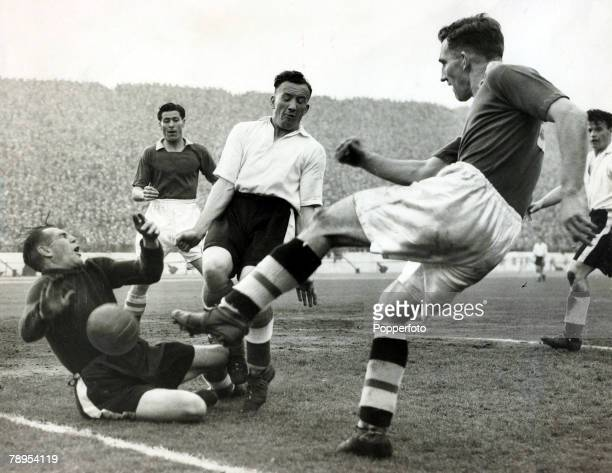 23rd April 1955 Division 1 Chelsea 3 v Sheffield Wednesday 0 at Stamford Bridge Chelsea centre forward Roy Bentley shoots for goal as Sheffield...