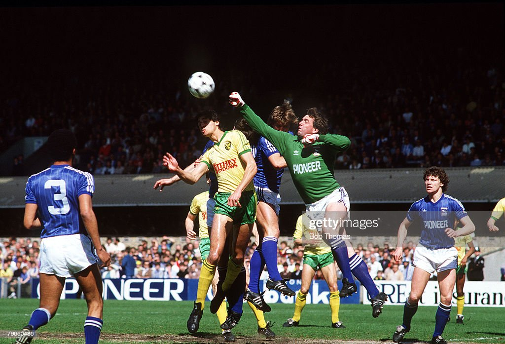 23rd April 1984, Ipswich Town,2,v Norwich City,0, Ipswich Town goalkeeper Paul Cooper punches clear under pressure from Norwich City's Robert Rosario, Paul Cooper was first choice goalkeeper in a successful era for the East Anglian side when they won the F,A,Cup in 1978 and the UEFA Cup in 1981