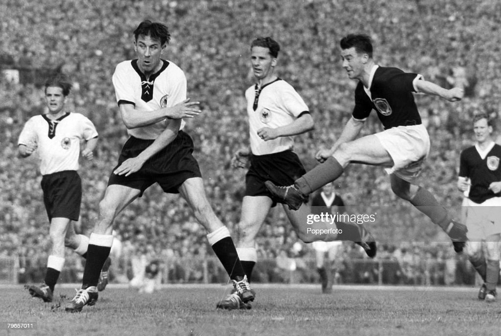 Sport, Football, pic: 23rd May 1957, Friendly International in Stuttgart, West Germany 1 v Scotland 3, Scotland's Tommy Ring shoots past West Germany defenders Wewers and Gerdau : News Photo
