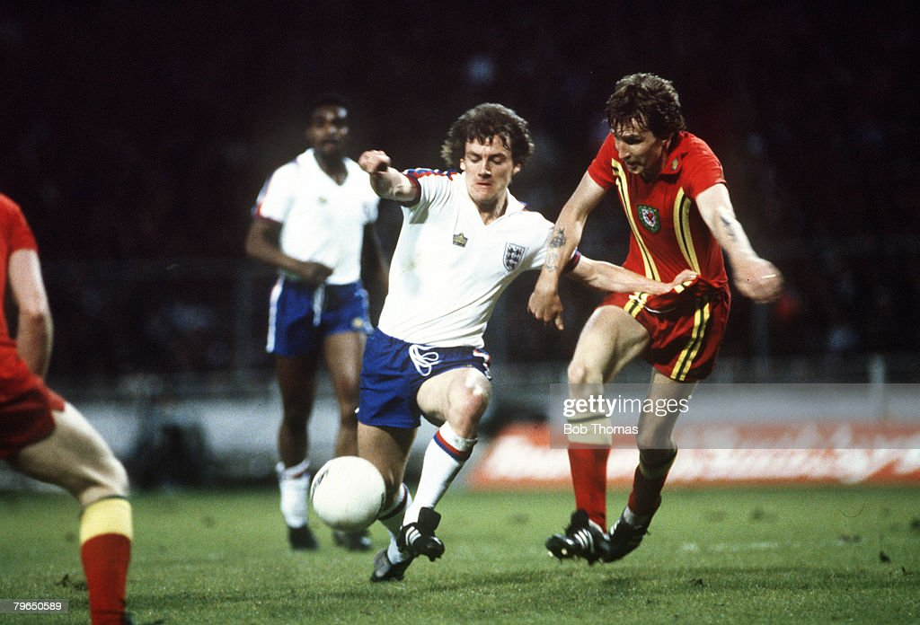 Sport, Football, pic: 23rd May 1979, British Championship, Wembley, England,0,v Wales,0, England's Steve Coppell, left, under pressure from Wales defender Joey Jones, Steve Coppell was a regular in the Manchester United side 1975-1983 and was a nippy righ : News Photo