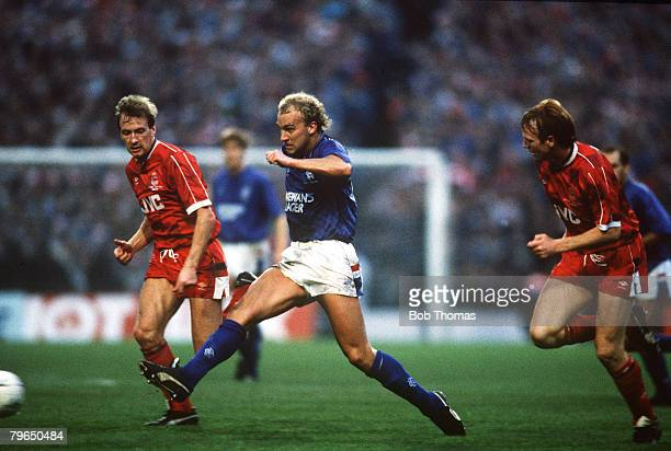 23rd October 1988 Skol Cup Final Rangers v Aberdeen Rangers' Neale Cooper plays the ball as Aberdeen's Neil Simpson left and Alex McLeish look on