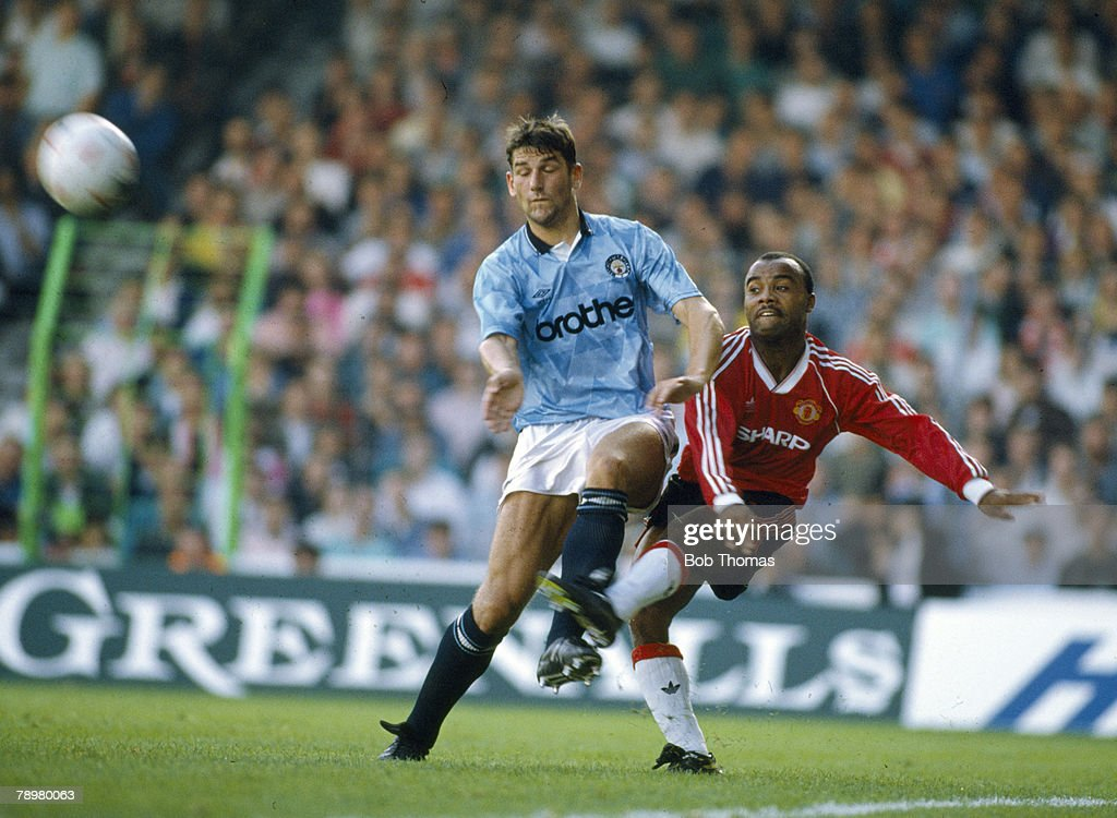 BT Sport. Football. pic: 23rd September 1989. Division 1. Manchester City 5 v Manchester United 1. Manchester United's Danny Wallace, right, crosses the ball past Manchester City's David White. : News Photo