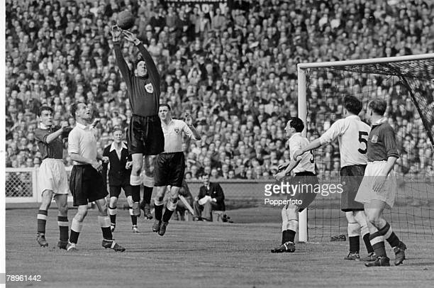 24th April 1948 1948 FA Cup Final at Wembley Manchester United 4 v Blackpool 2 Blackpool goalkeeper Joe Robinson stretches for a high ball in a...