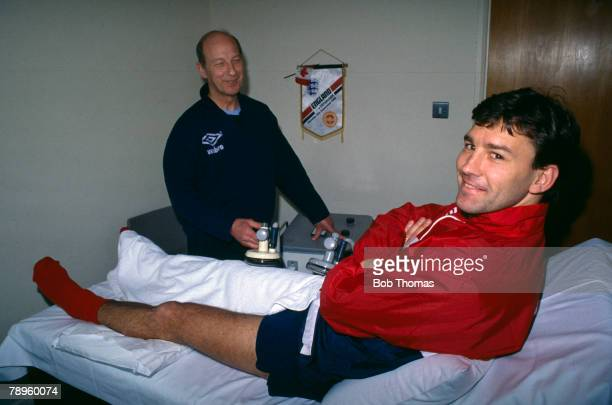 24th April 1989, England Training,England captain Bryan Robson on the treatment table receiving treatment from Physio Fred Street