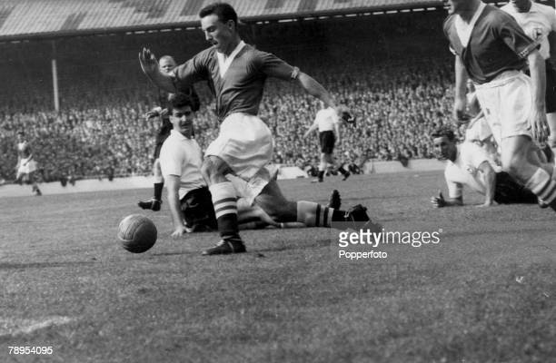 24th August 1957 Division 1 Tottenham Hotspur 1 v Chelsea 1 at White Hart Lane Chelsea's 17 year old star Jimmy Greaves leaves Tottenham pair Maurice...