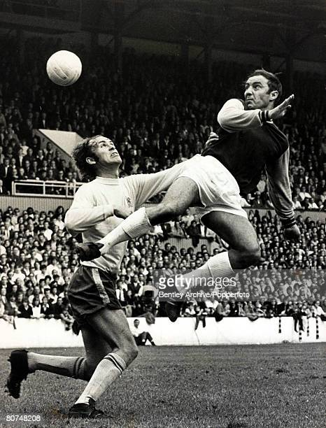 24th August 1970 Division 1 West Ham United v Chelsea West Ham United's Jimmy Greaves right jumps for the ball with Chelsea's John Dempsey