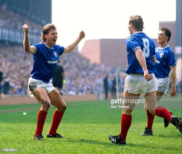 25th April 1987 Scottish Premier Division Rangers 3 v Hearts 0 Rangers' striker Ally McCoist left celebrates after completing his hattrick
