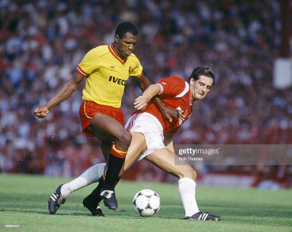 Sport. Football. pic: 25th August 1984. Division 1. Manchester United 1 v Watford 1. Watford's Luther Blissett, left, is challenged by Manchester United defender Graeme Hogg. : News Photo