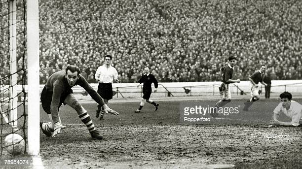 25th January 1954, Division 1, Chelsea, v Huddersfield, Huddersfield goalkeeper Henry Mills can only watch as Chelsea's John McNichol, 3rd right, has...