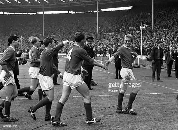 25th May 1963 1963 FA Cup Final at Wembley Manchester United 3 v Leicester City 1 Denis Law leading a group of Manchester United players shakes hands...