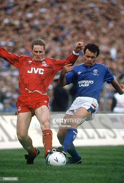25th October 1987 Skol Cup Final at Hampden Park Rangersv Aberdeen Rangers win 53 on penalties Rangers' Davie Cooper right challenged by Aberdeen's...