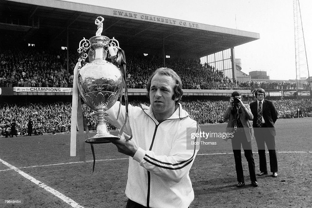 BT Sport, Football, pic: 26th April 1975, Division 1, Derby County v Carlisle United, Derby County captain Archie Gemmill holds aloft the League Championship trophy at the Baseball Ground, as Derby win the title : News Photo