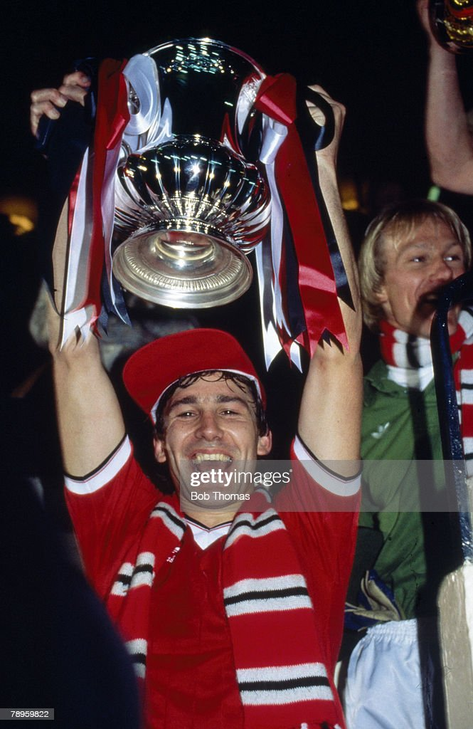 Sport. Football. pic: 26th May 1983. 1983 FA. Cup Final replay at Wembley. Manchester United 4 v Brighton and Hove Albion 0. Manchester United captain Bryan Robson lifts the FA. Cup. : News Photo