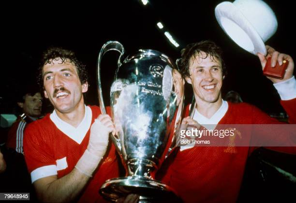 27th May 1981 European Cup Final in Paris Liverpool 1 v Real Madrid 0 Liverpool's Phil Neal right and goalscorer Alan Kennedy parade the European Cup...