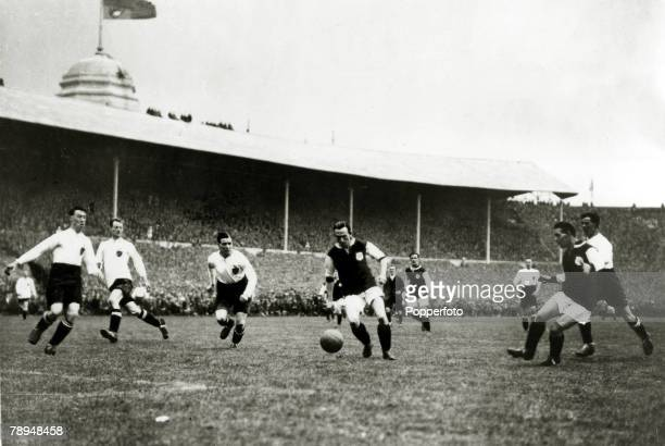 28th April 1923 FACup Final at Wembley Bolton Wanderers 2 v West Ham United 0 Official Attendance 126 West Ham United on the attack as Moore receives...