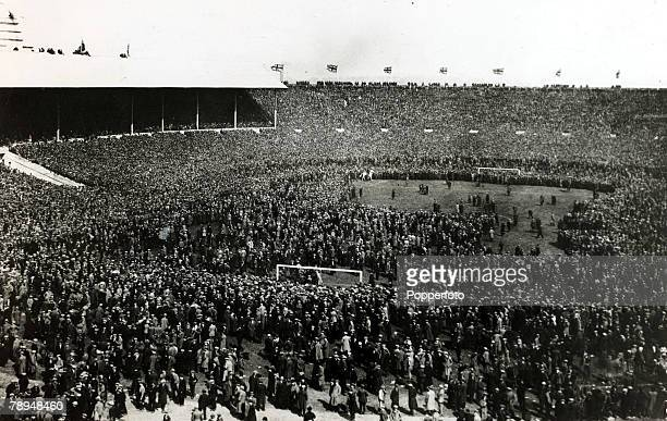 28th April 1923 FACup Final at Wembley Bolton Wanderers 2 v West Ham United 0 Official Attendance 126 Part of the huge crowd overflows from the...