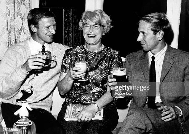 28th July 1966 England internationals Jack left and Bobby Charlton enjoy a celebration drink with their mother Cissie after the World Cup SemiFinal...
