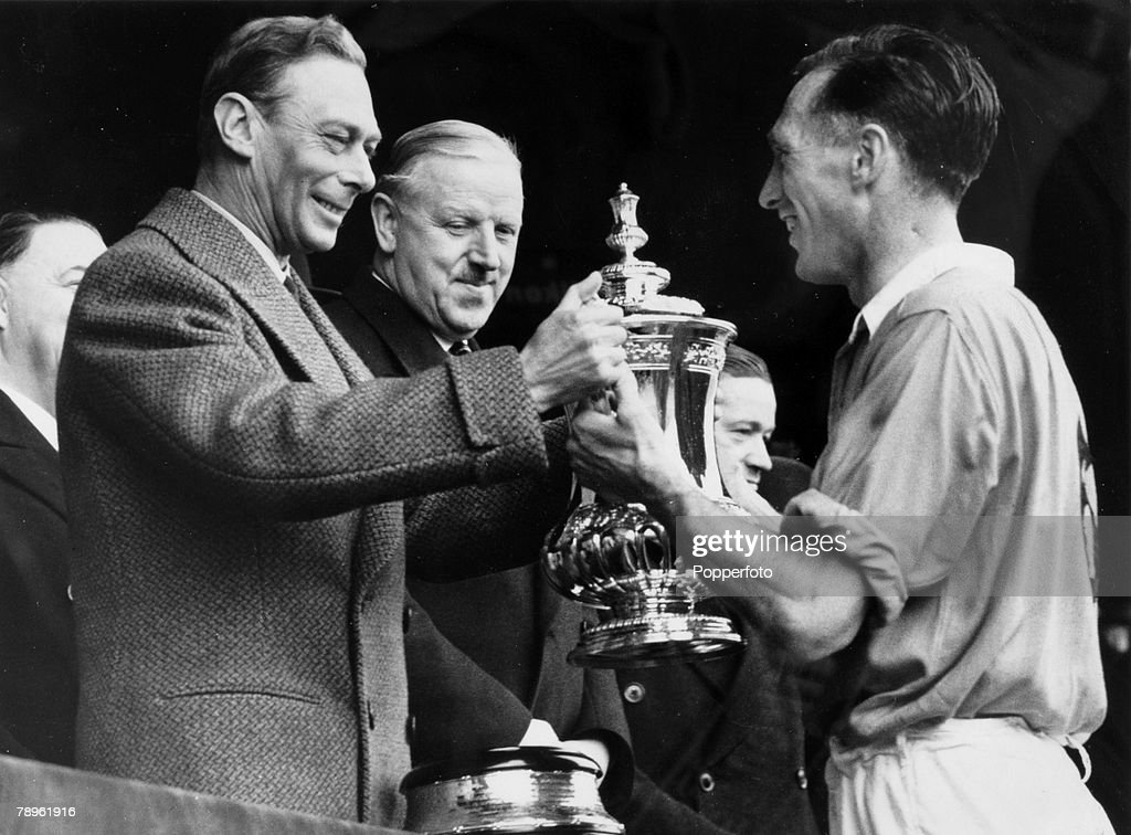 29th April 1950, FA, Cup Final at Wembley, Arsenal 2 v Liverpool 0, Arsenal captain Joe Mercer receives the FA, Cup from H,M,King George VI, as Sir Stanley Rous looks on