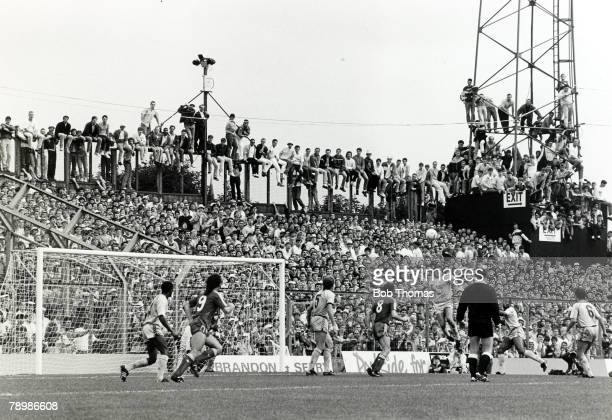 29th August 1987 Division 1 Coventry City 1 v Liverpool 4 Liverpool fans packed into Highfield Road climb the fence and floodlight to get a better...