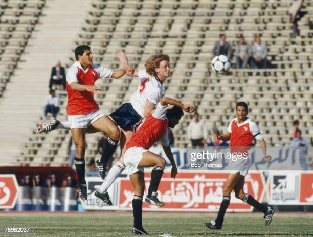 29th January 1986 Friendly International in Cairo Egypt 0 v England 4 England central defender Mark Wright outjumps the Egyptian defenders Mark...