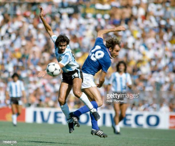 29th June 1982 1982 World Cup Finals in Spain Italy 2 v Argentina 0 in Barcelona Argentina's Jorge Olguin contests the ball with Italy's Francesco...