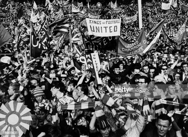 29th May 1968 European Cup Final at Wembley Manchester United 4 v Benfica 1 Excited Manchester United fans waving banners and scarves as they watch...