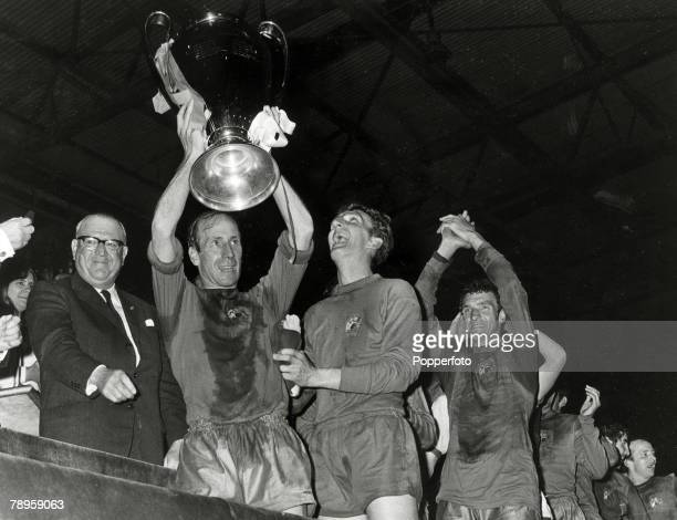 29th May 1968 European Cup Final at Wembley Manchester United 4 v Benfica 1 Manchester United captain Bobby Charlton lifts the European Cup watched...