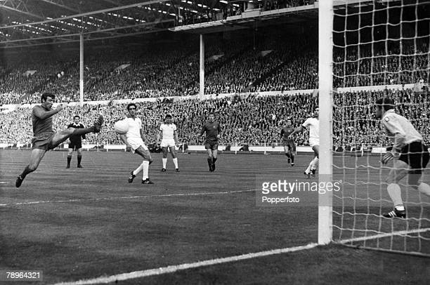 29th May 1968 European Cup Final at Wembley Manchester United 4 v Benfica 1 Manchester United's David Sadler left stretches to get in a shot on the...