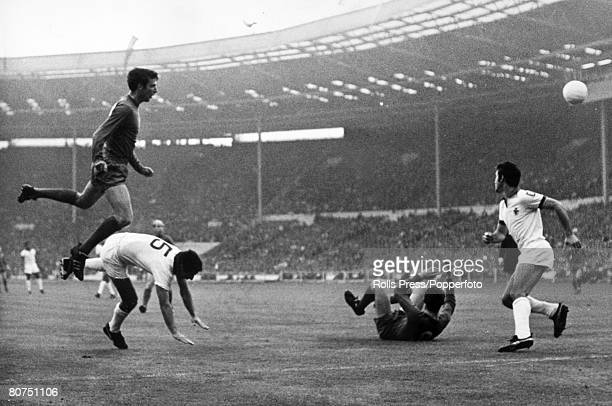 29th May 1968 European Cup Final at Wembley Manchester United 4 v Benfica 1 Manchester United's David Sadler left leaps high above Benfica's Cruz as...