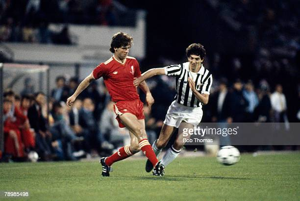 29th May 1985, European Cup Final in Brussels, Liverpool 0 v Juventus 1, Liverpool's Jim Beglin plays the ball as Juventus striker Paolo Rossi...