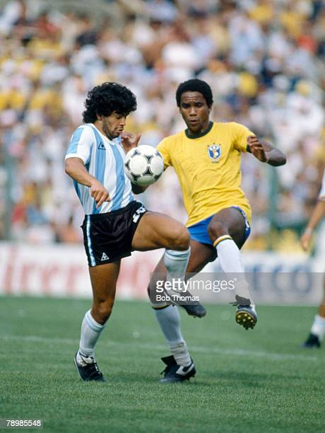 2nd July 1982 1982 World Cup Finals Brazil 3 v Argentina 1 in Barcelona Argentina's Diego Maradona and Brazil's Serginho in a tussle for the ball