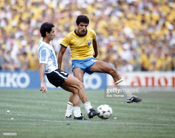 2nd July 1982 1982 World Cup Finals Brazil 3 v Argentina 1 in Barcelona Argentina's Osvaldo Ardiles plays the ball as Brazil's Toninho Cerezo...