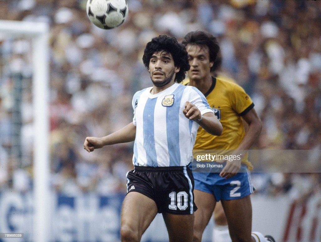Sport. Football. pic: 2nd July 1982. 1982 World Cup Finals in Spain. Brazil 3 v Argentina 1 in Barcelona. Argentina's Diego Maradona gets to the ball ahead of Brazil's Leandro. : News Photo