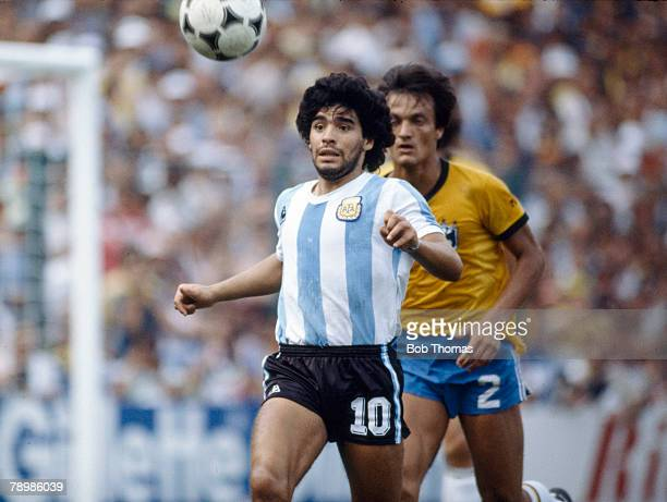 2nd July 1982 1982 World Cup Finals in Spain Brazil 3 v Argentina 1 in Barcelona Argentina's Diego Maradona gets to the ball ahead of Brazil's Leandro
