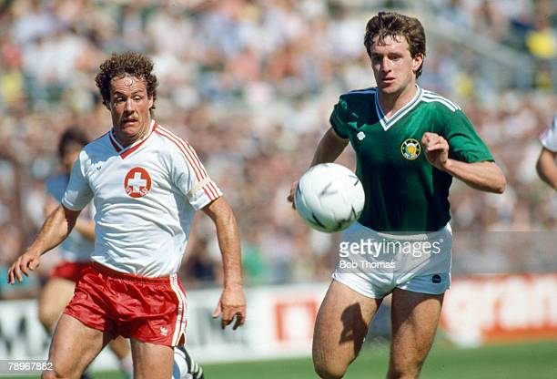 2nd June 1985 World Cup Qualifier in Dublin Republic of Ireland 3 v Switzerland 0 Republic of Ireland's Kevin Sheedy right racing with Switzerland's...