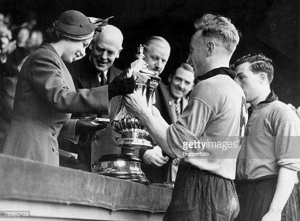 30th April 1949 1949 FA Cup Final at Wembley Wolverhampton Wanderers 3 v Leicester City 1 The 'Wolves' captain Billy Wright receives the FA Cup from...