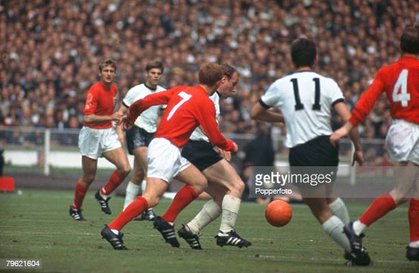 30th July 1966 1966 World Cup Final at Wembley England 4 v West Germany 2 after extra time England's Alan Ball chases West Germany's Uwe Seeler as...