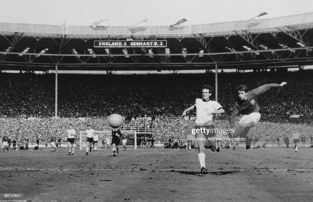 Sport Football. pic; 30th July 1966. 1966 World Cup Final at Wembley. England 4 v West Germany 2 a.e.t. England's Geoff Hurst scores 4th goal as West Germany's Wolfgang Overath can only watch. : News Photo