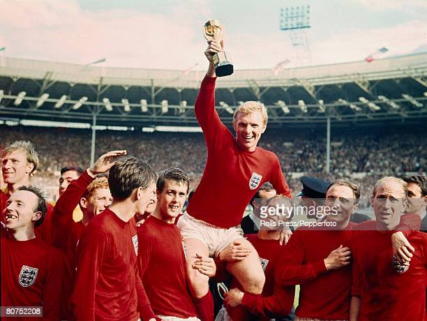 30th July 1966, 1966 World Cup Final at Wembley, England 4 v West Germany 2 a,e,t, England captain Bobby Moore holds aloft the World Cup as the team,...