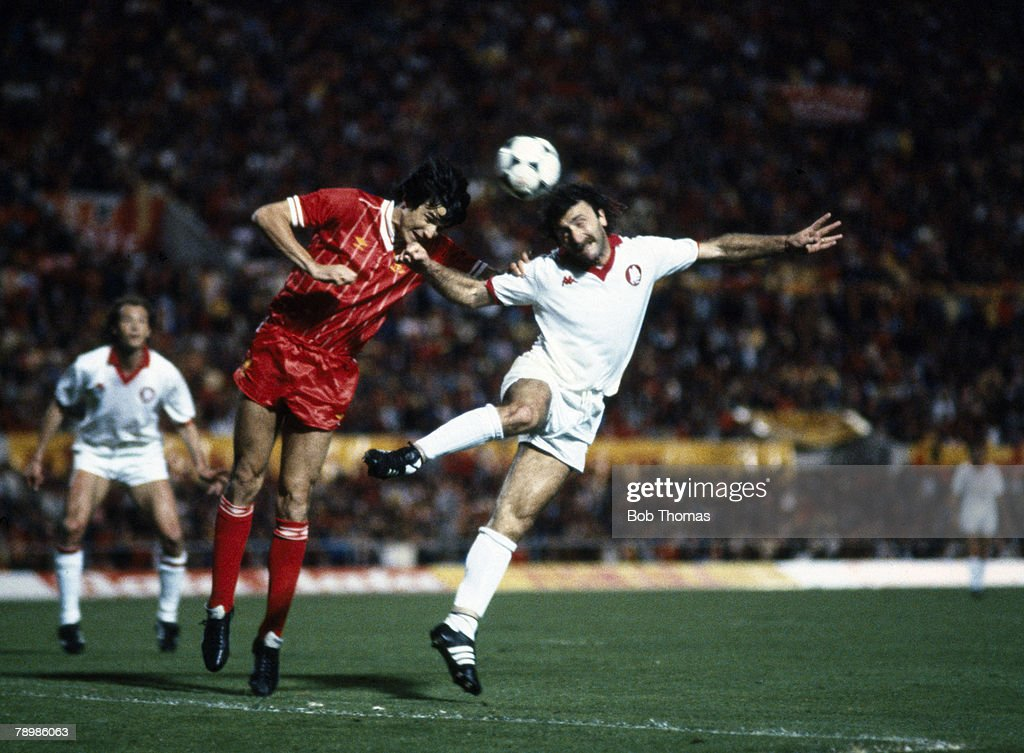 Sport. Football. pic: 30th May 1984. European Cup Final in Rome. Roma 1 v Liverpool 1. after extra time. (Liverpool win 4-2 on penalties). Liverpool's Alan Hansen, left is beaten to a high ball by Roma's Roberto Pruzzo, who scores Roma's goal with a heade : News Photo
