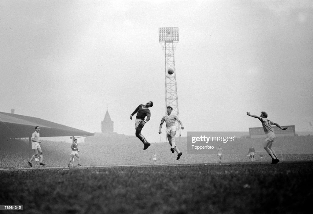 Sport. Football. pic: 31st December 1960. Division 1. Manchester United 5.v Manchester City 1 at Old Trafford. Manchester United's Alex Dawson (centre,dark shirt) stretches for a high ball, as Manchester City's Denis Law (far right) soon to play for Unite : News Photo