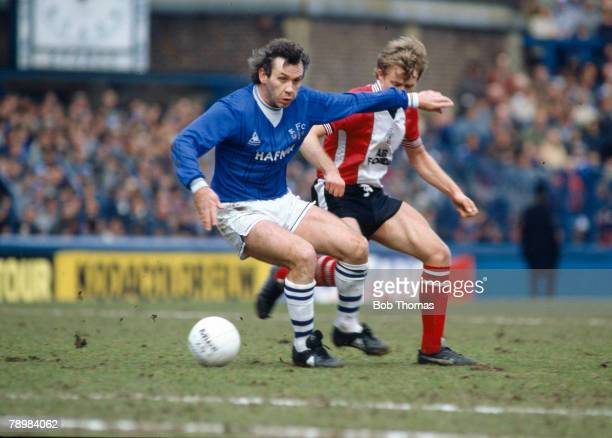 31st March 1984 Division 1 Everton 1 v Southampton 0 Everton's Peter Reid on the ball with Southampton's Mark Dennis challenging