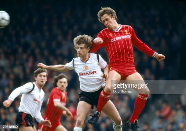 31st March 1985 Division 1 Liverpool 0 v Manchester United 1 Liverpool full back Phil Neal outjumps Manchester United's Jesper Olsen to win the high...