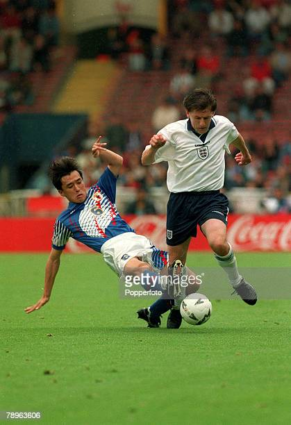 3rd June 1995 International Football Umbro Cup at Wembley England 2 v Japan 1 England's Peter Beardsley challenged by Japan's Motohiro Yamaguchi